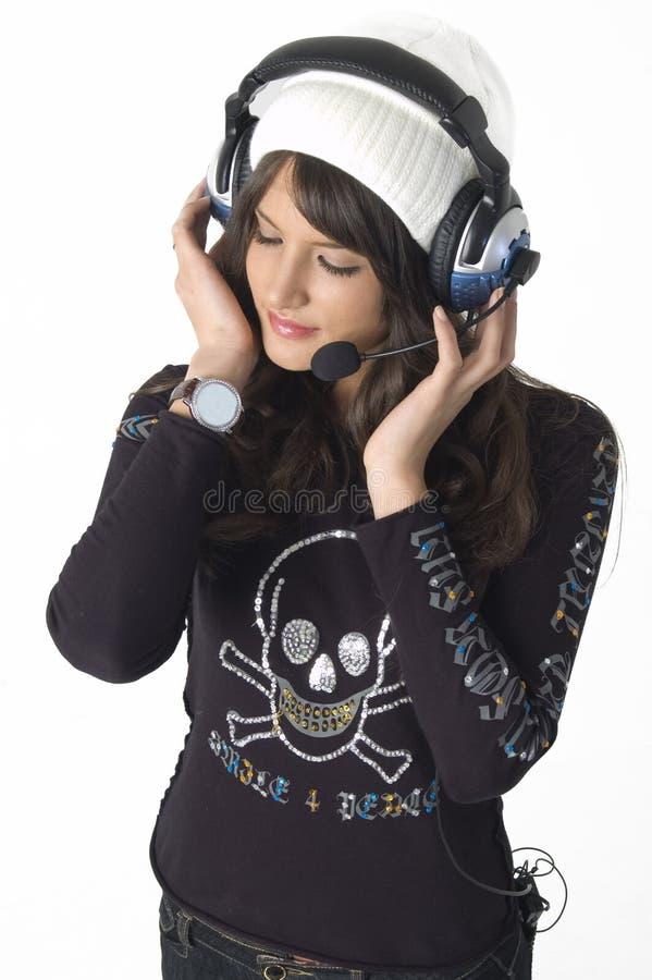 nätt kvinnabarn för hörlurar arkivfoton