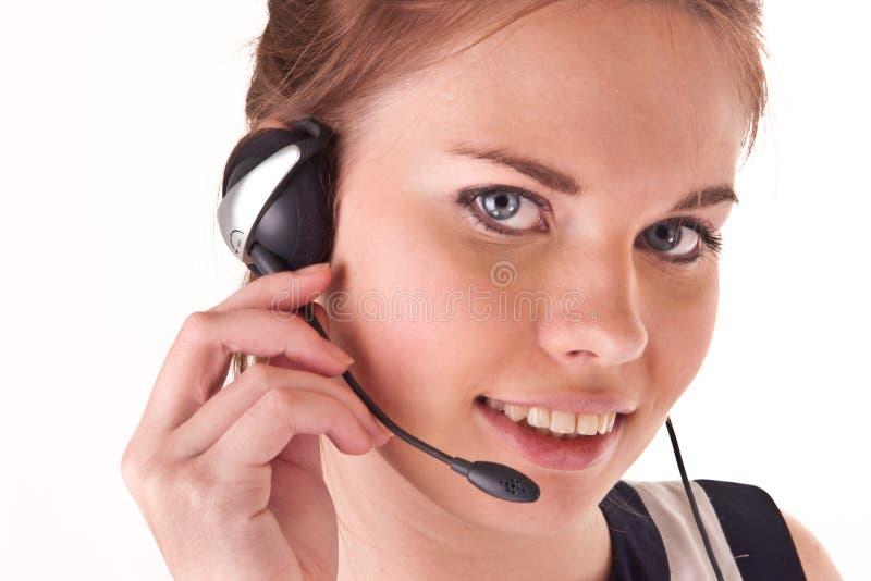 nätt leende för flickahörlurar med mikrofon royaltyfri bild