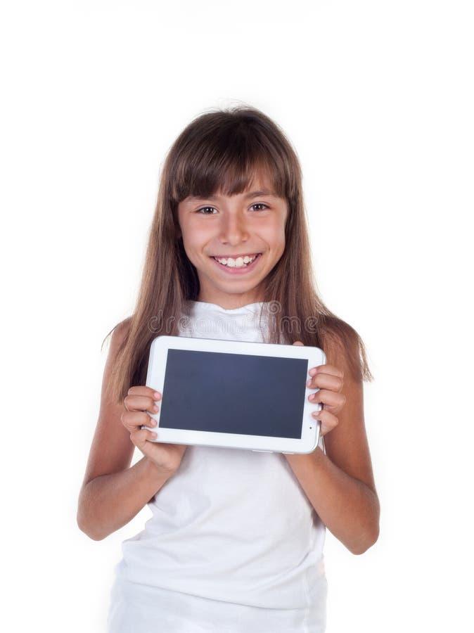 Nätt liten flicka med en minnestavlaPC fotografering för bildbyråer