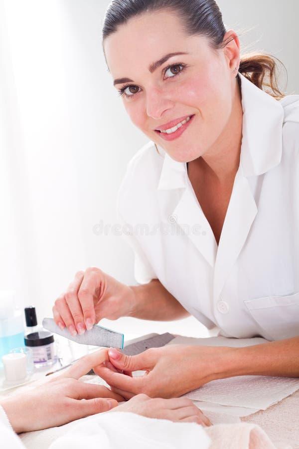 nätt manicurist royaltyfri fotografi