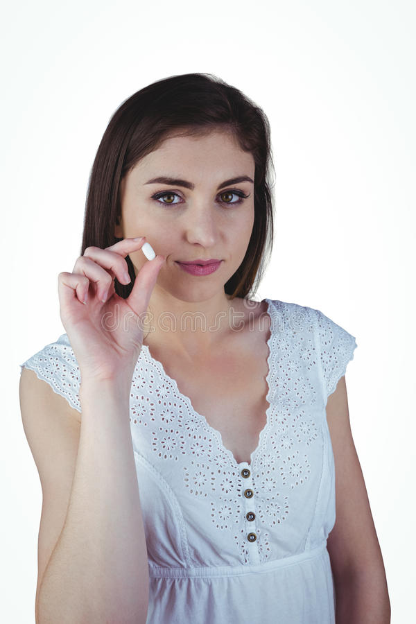 Nätt preventivpiller för kvinnavisningvit arkivbilder