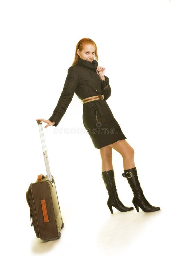 nätt resväskakvinna royaltyfria foton