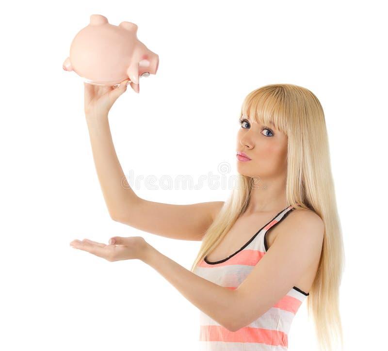 Nätt uppochnervänd kvinnaholdingpiggybank royaltyfria foton