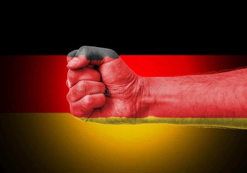 Näve över flagga av Tyskland fotografering för bildbyråer