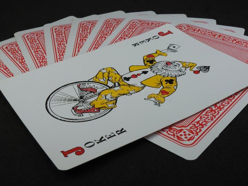 Några spela kort Joker vänder mot upp, överst av korten fotografering för bildbyråer