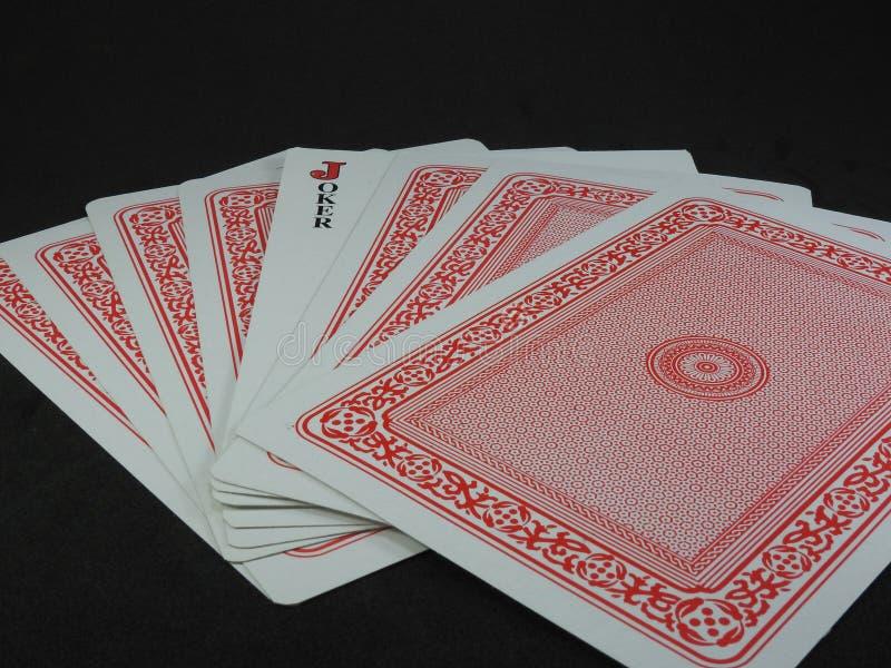 Några spela kort Joker vänder mot upp, bland korten arkivbild