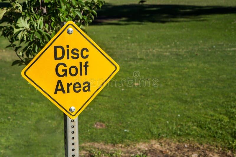 nós jogamos o golfe do disco aqui fotografia de stock royalty free