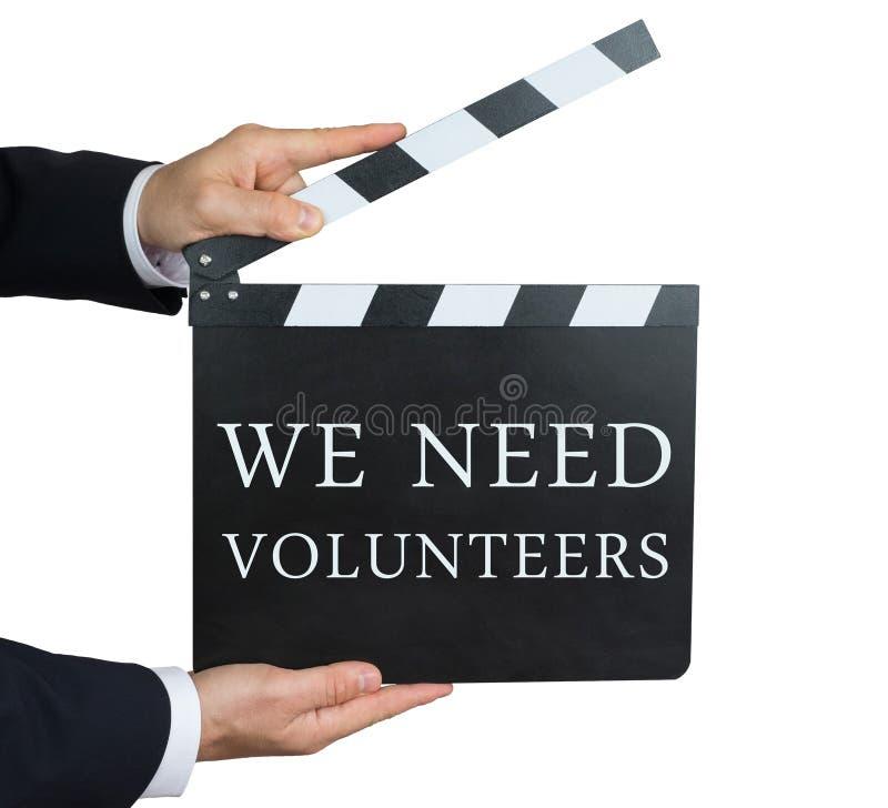 Nós precisamos voluntários foto de stock