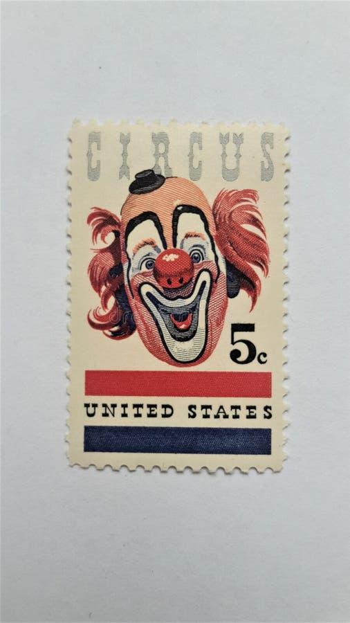 Nós selo postal com teste padrão de Circus do palhaço do pino-Acima foto de stock royalty free