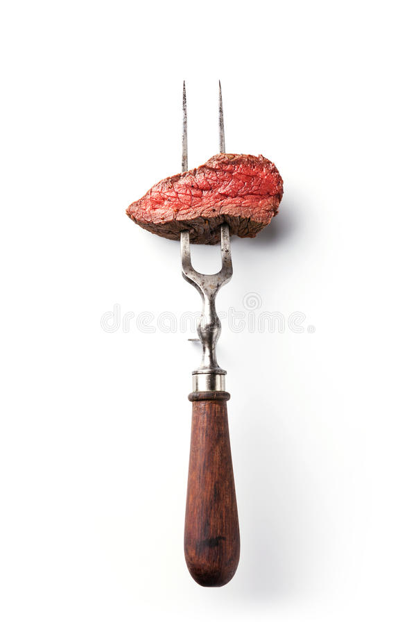 Nötköttbiff på köttgaffel fotografering för bildbyråer