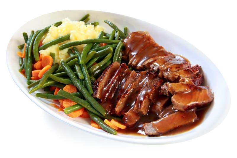 nötköttstekgrönsaker royaltyfria bilder