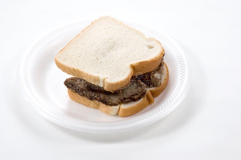 Download Nötköttsteksmörgås fotografering för bildbyråer. Bild av äta - 289843