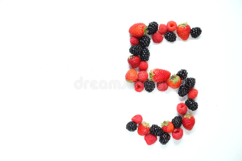 Número cinco com frutas imagem de stock royalty free