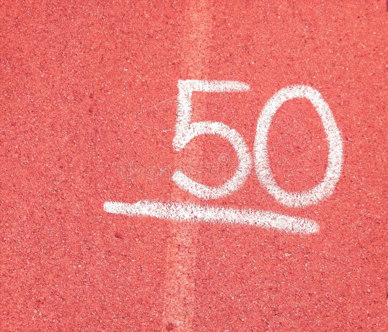 Número 50 cinqüênta no fundo vermelho imagens de stock royalty free