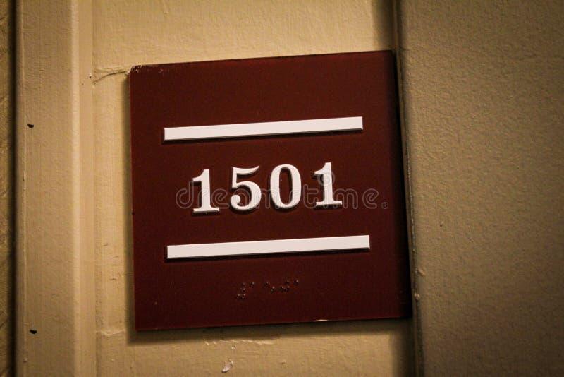 Número de sala do hotel fotografia de stock
