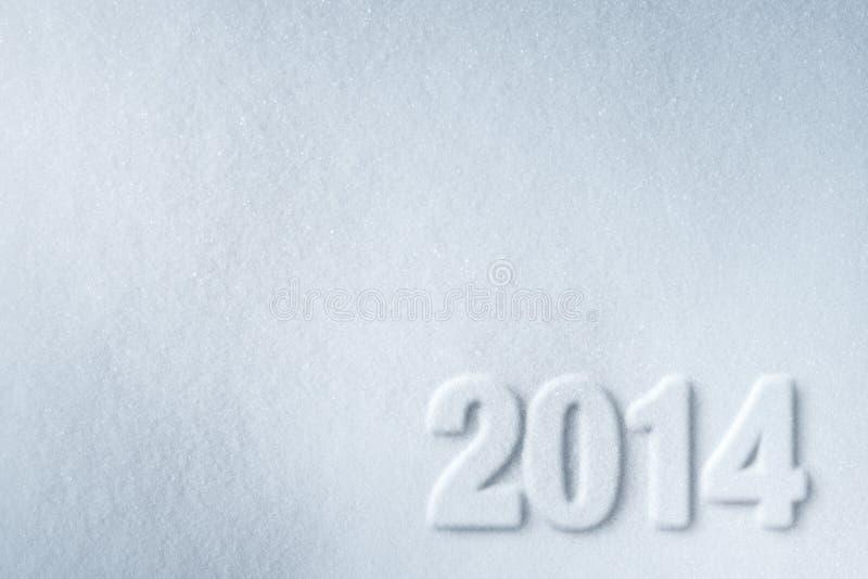 número del Año Nuevo 2014 en fondo de la nieve imagen de archivo