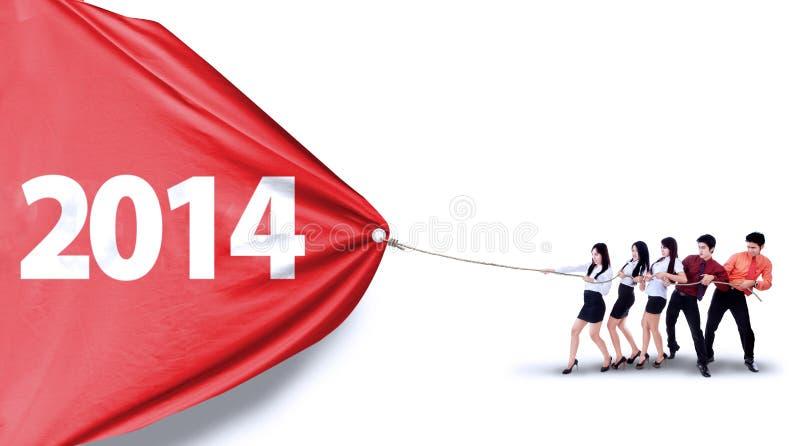 Número del tirón del trabajo en equipo del negocio de 2014 fotografía de archivo libre de regalías