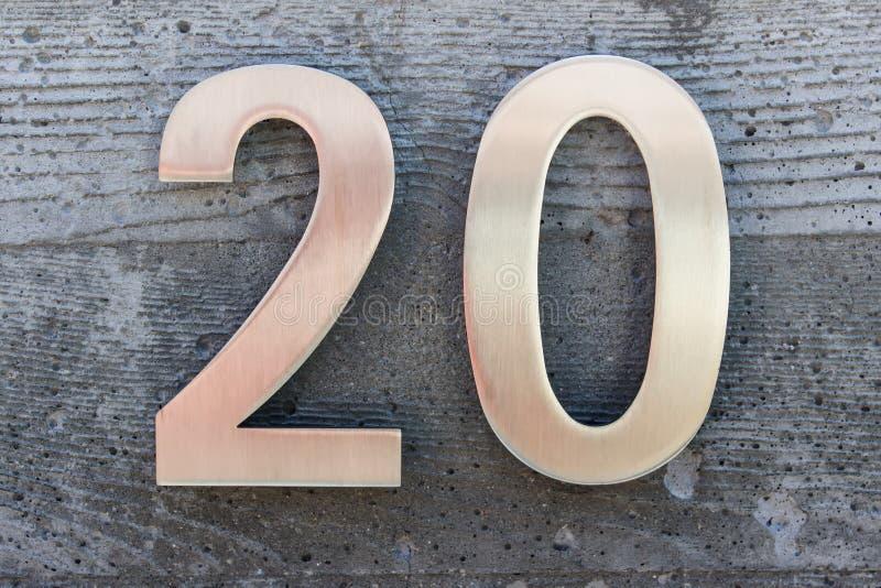 Número metálico de oro 20 imagen de archivo