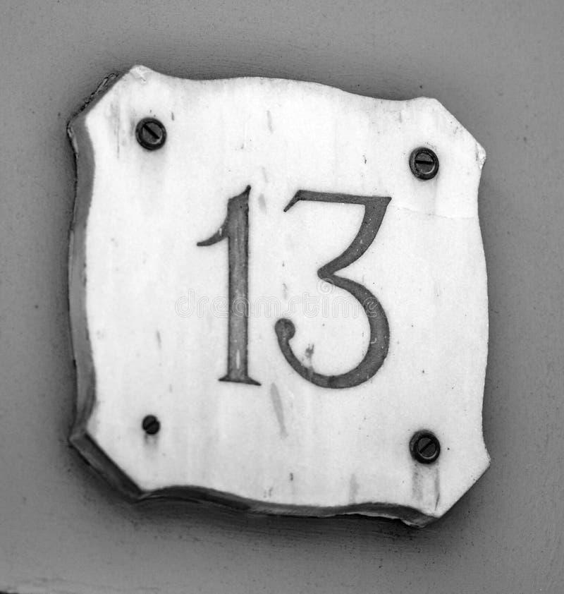 Número 13 na parede da casa fotografia de stock royalty free