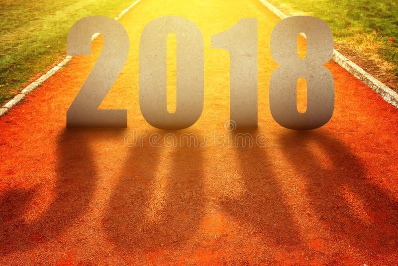 Número 2018 na pista de atletismo imagem de stock royalty free