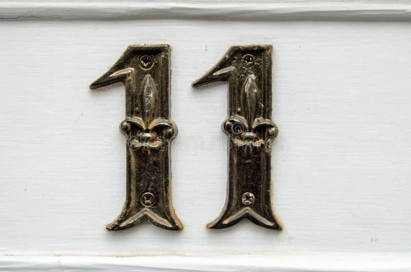 Número once en la puerta fotografía de archivo libre de regalías
