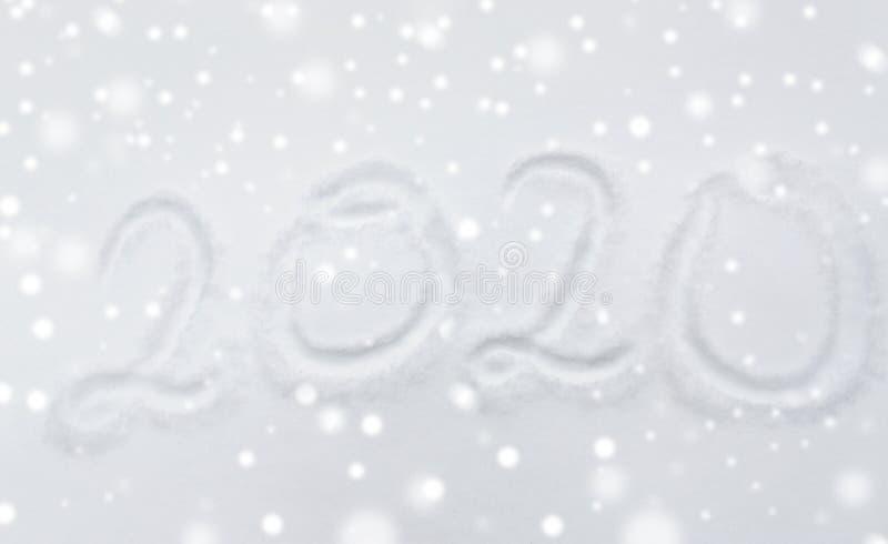 Número ou data do ano novo 2020 na superfície da neve imagens de stock