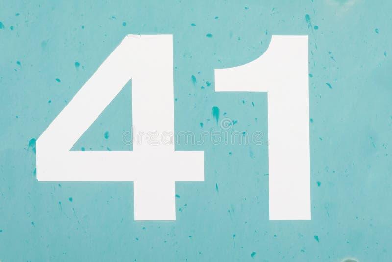 Número 41 quarenta uma textura velha azul do fundo do metal imagens de stock royalty free