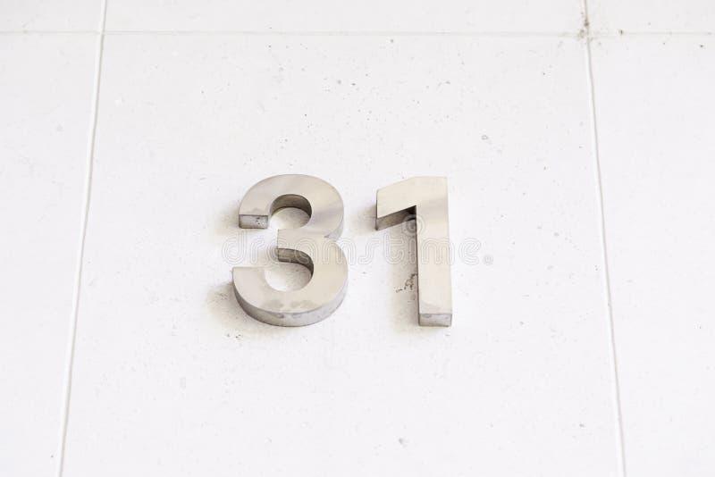 Número treinta y uno en una pared fotografía de archivo libre de regalías