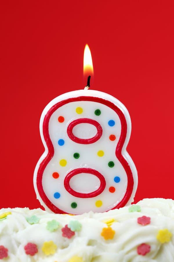 Número vela de ocho cumpleaños imagenes de archivo