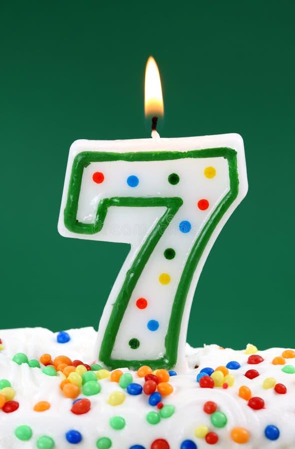 Número vela de sete aniversários fotos de stock royalty free