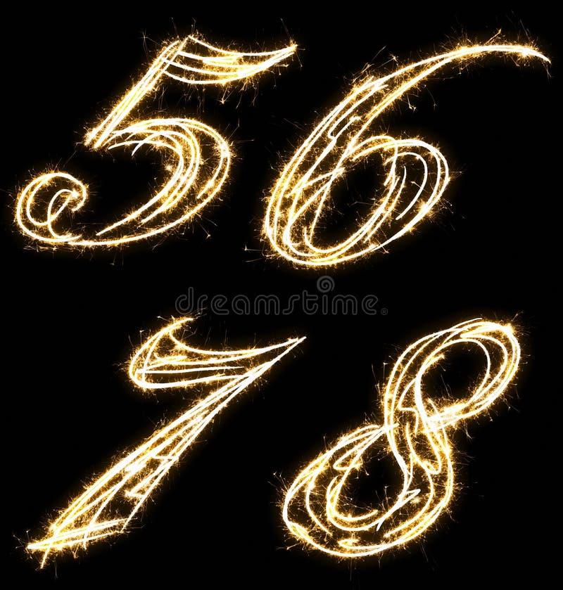 Números cinco, seis, siete, ocho, hechos de bengala Aislado en un fondo negro imagen de archivo