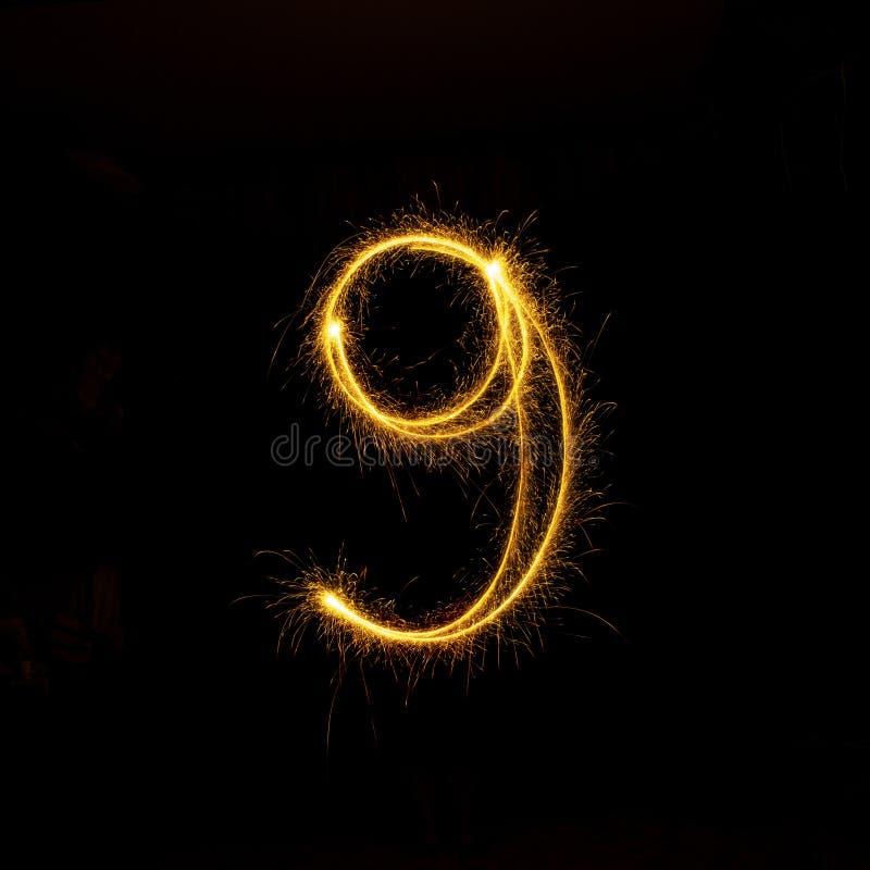 Números 0 a 9 creados usando una bengala en negro imagen de archivo libre de regalías