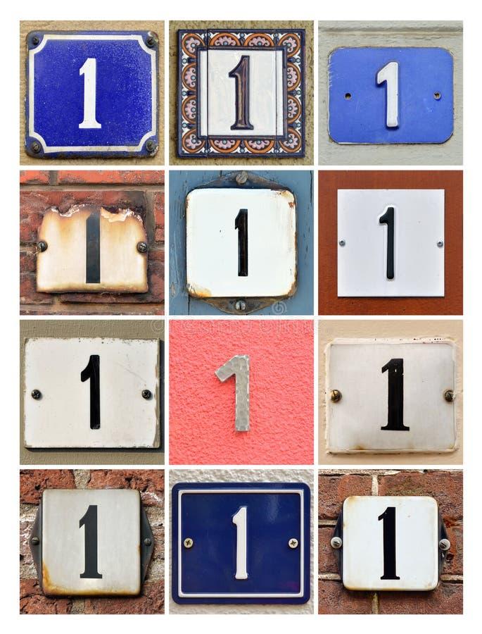Números de casa uno fotos de archivo