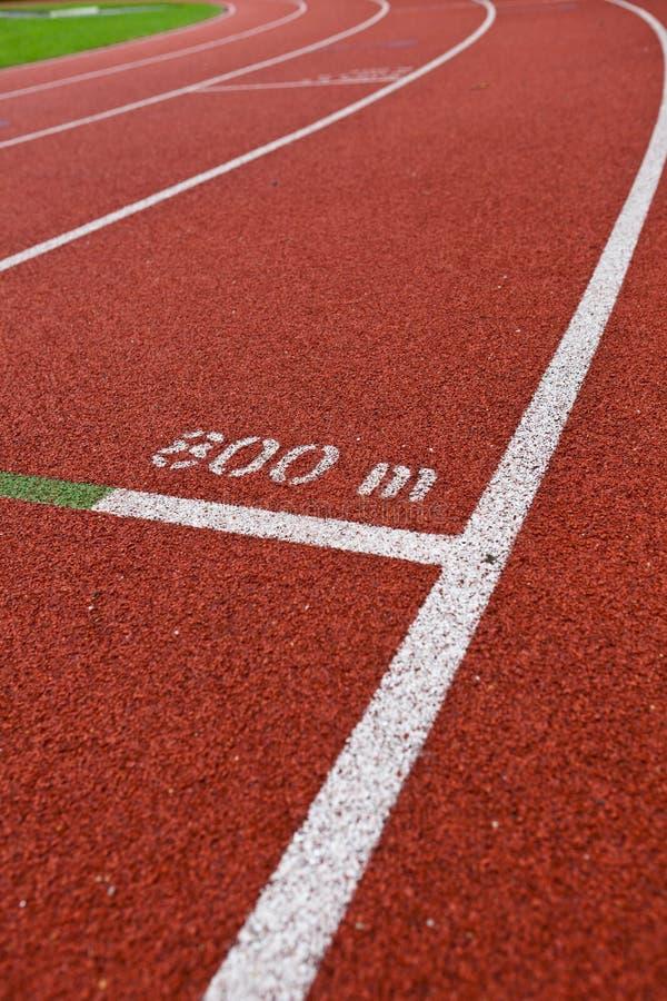 Números del carril de la pista del atletismo foto de archivo