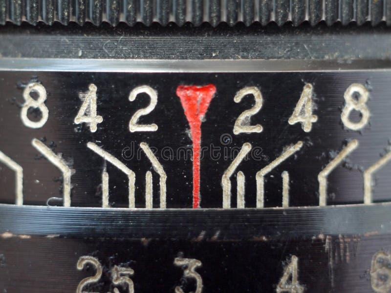 Números macro na lente velha fotografia de stock