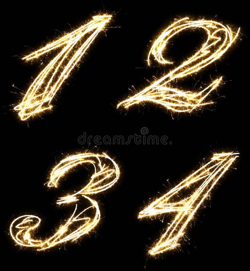 Números uno, dos, tres, cuatro, hechos por la bengala Aislado en un fondo negro imagen de archivo