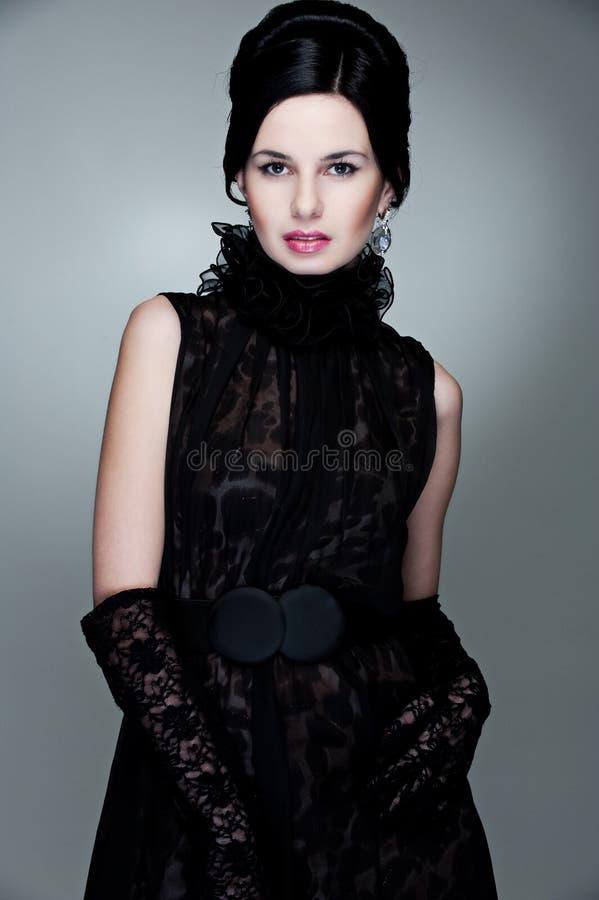 nęcąca czerń sukni rękawiczek kobieta fotografia royalty free