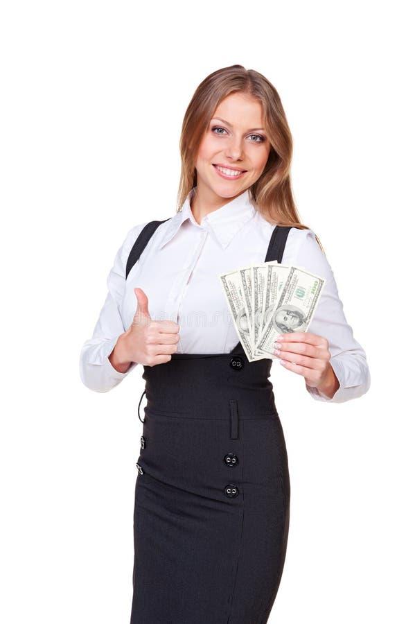 Nęcący bizneswomanu mienia pieniądze obraz royalty free