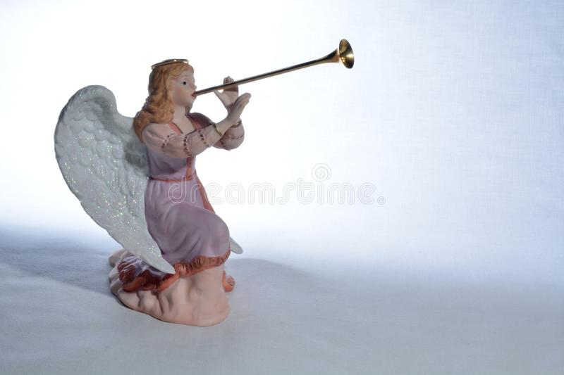 Angel playing Herald trumpet royalty free stock images