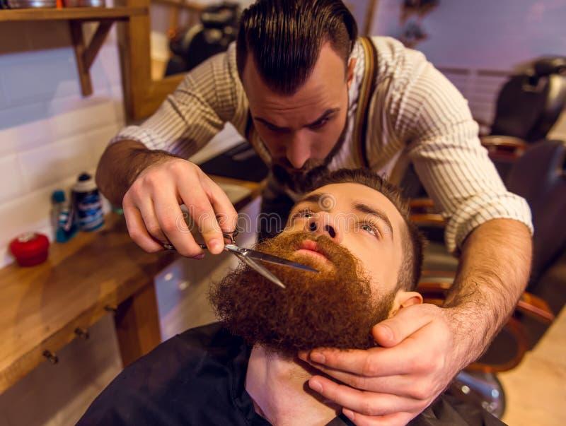 Na barbearia imagem de stock royalty free