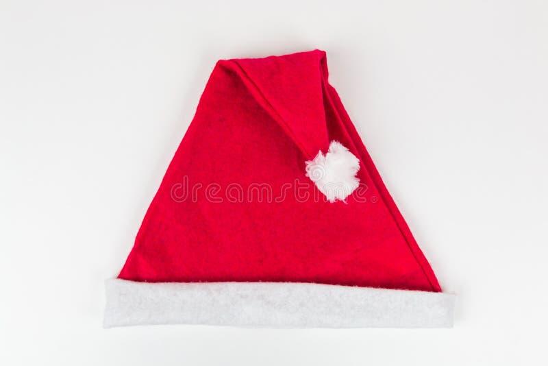 Na biały tle Święty Mikołaj kapelusz zdjęcie royalty free