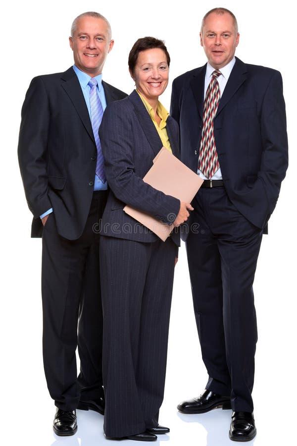 Na biel dojrzali ludzie biznesu obraz stock