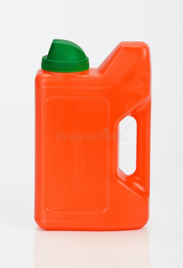 Na biel plastikowa butelka obraz stock