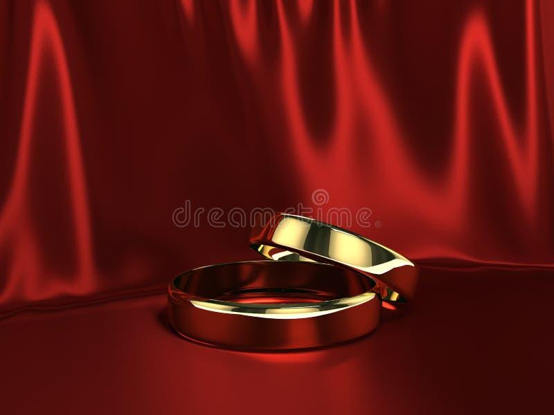 Na czerwonym jedwabiu dwa złocistego pierścionku ilustracji