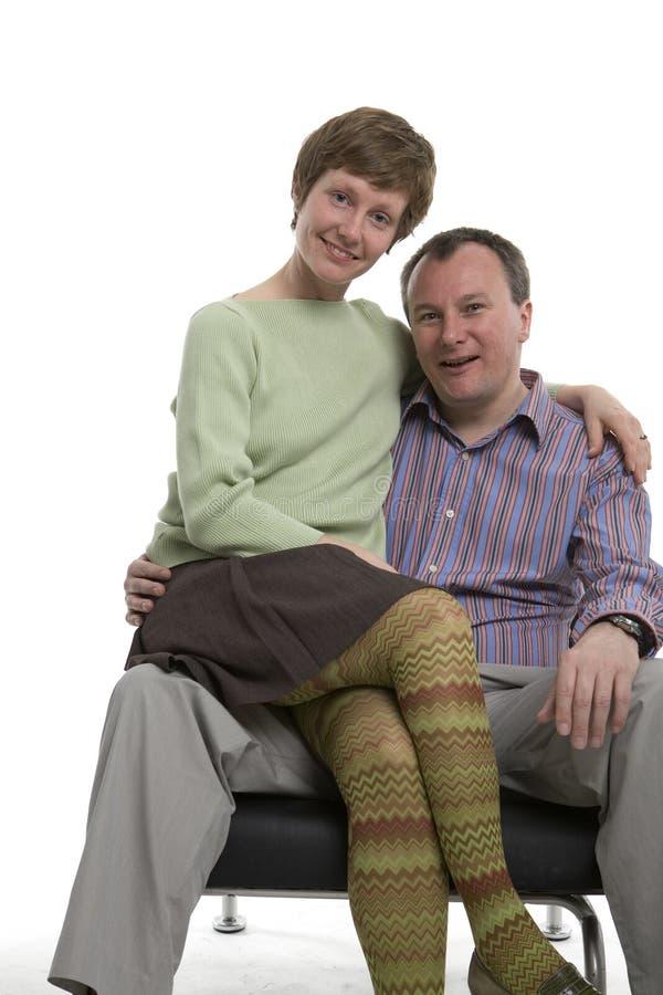 Na jego kolanie fotografia stock