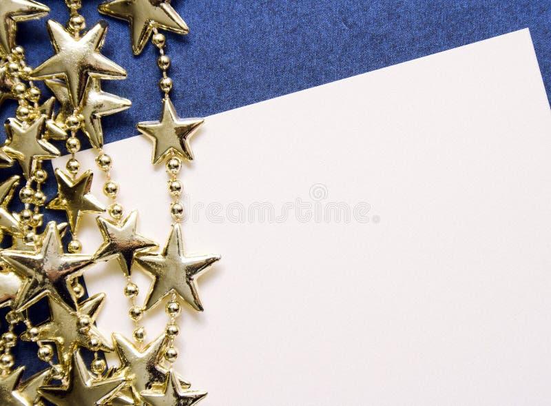 Na Kartka bożonarodzeniowa złote gwiazdy zdjęcia royalty free