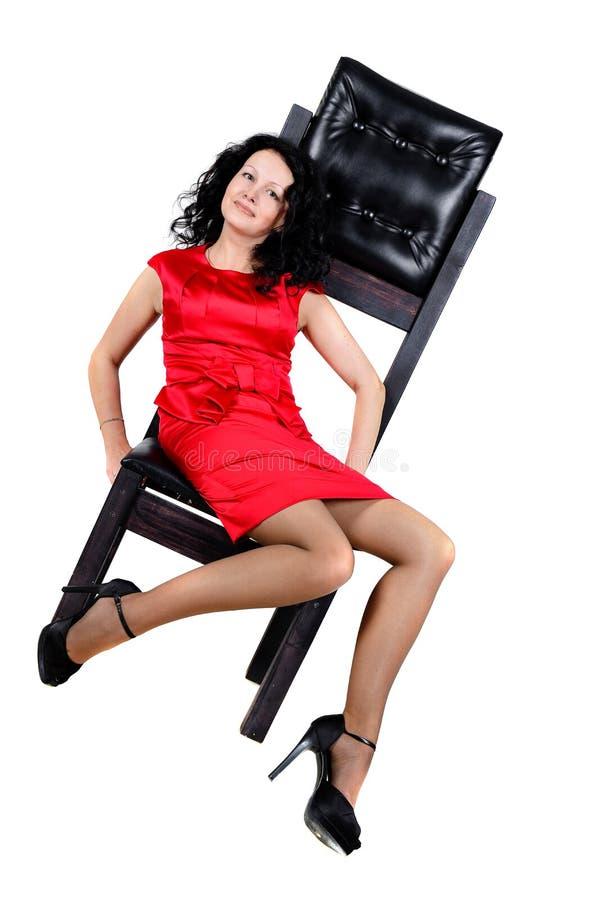 Na krześle brunetki kobieta obrazy royalty free