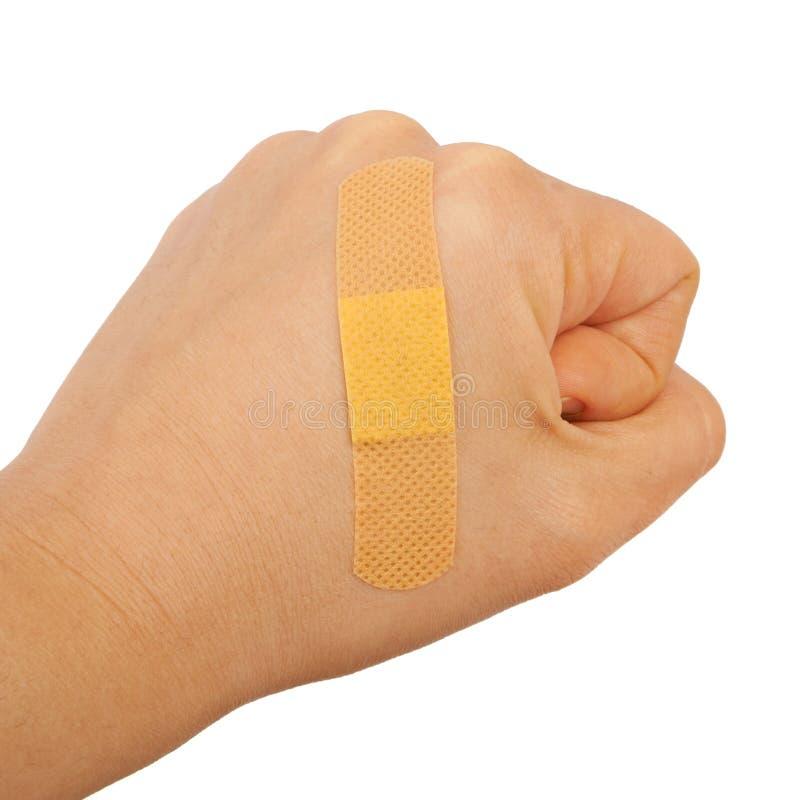 Na mężczyzna ręki pięści kleiąca medyczna tynk pierwszej pomocy tynku reklama obrazy royalty free