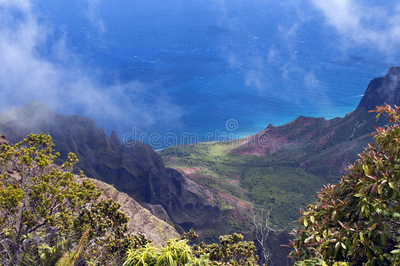 Na Pali Coast from Waimea Canyon. With clouds, mountains, and valley leading to the coast stock photo