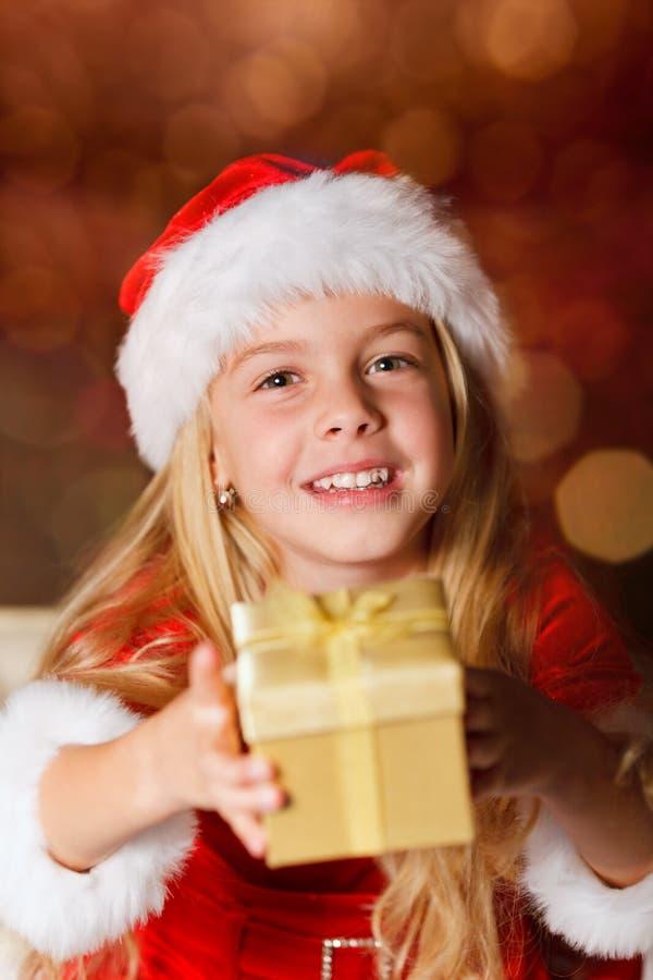 na Santa con un regalo immagini stock